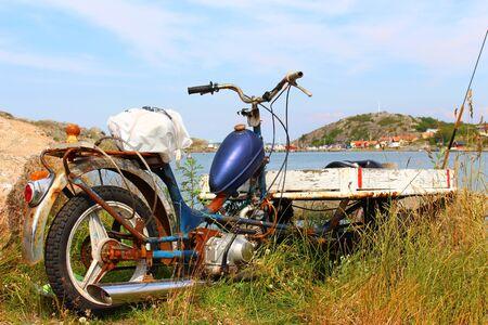 gothenburg: A rusty motorbike abandoned on the coast of the Swedish island of Branno near Gothenburg
