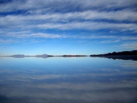 salar de uyuni: Blue sky reflected in the still water of Salar de Uyuni salt flats in Bolivia