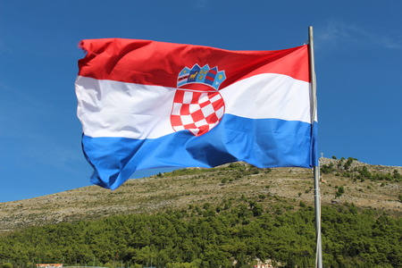 croatian: Croatian flag waving above the city of Dubrovnik