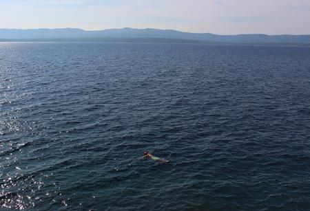bather: Bather floating in the Adriatic Sea off the island of Brac in Croatia