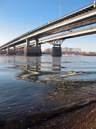 coast line: On a big river. Bridge.