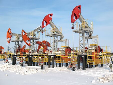Industrial construction and mechanism. Work of oil industry.  Stock Photo