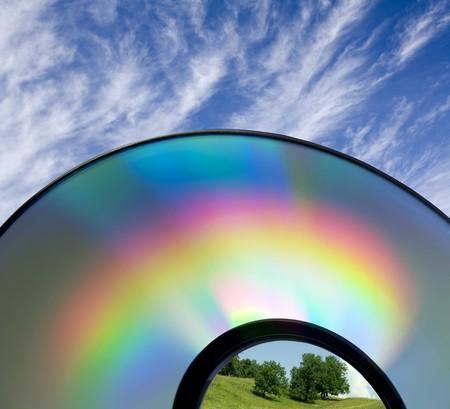 Rainbow op een compact disk. Milieu behoud. Gezondheid en leefstijl