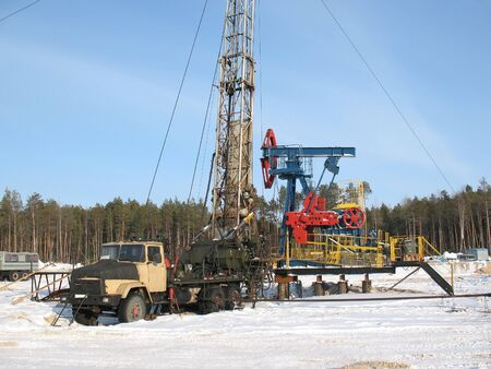 Industrial construction and mechanism. Work of oil industry. Mounting of pipework in wild Siberian taiga.