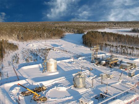 swapping: Oil extraction. Oil industry. Construction and mechanism in work. Aerial view.   Stock Photo