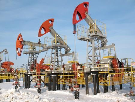 Et le mécanisme de la construction industrielle. Travaux de l'industrie pétrolière. Banque d'images - 4044860