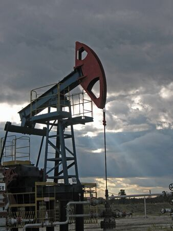 Oil sunset. Pump in beams. Stock Photo - 4044790