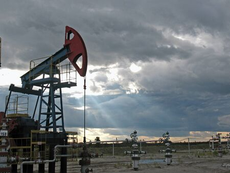 Pump on sunset. West Siberia. Stock Photo - 4044891