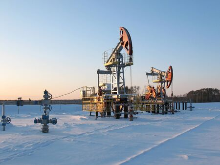 pipework: Oil pump jack in work. Oil industry in West Siberia. Siberian frost in sunny day.