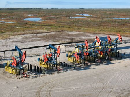Oil pumps on a swamp. Stock Photo - 4060142