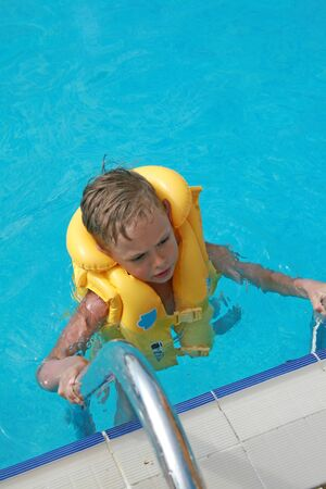 Littke boy in water pool Stock Photo