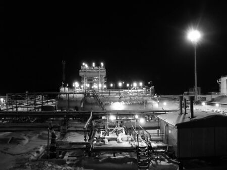 Night work on a oil and gas refinery center. Black and white photo Stock Photo - 4375861