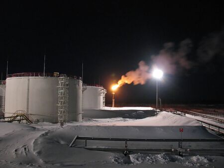 Oil and gas refinery plant. Winter frost. Night scene photo