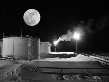 Oil refinery station. Night landscape. Beautiful moon. Black and white photo Stock Photo