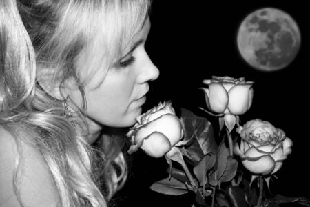Beautiful present to birthday . Young women and pink roses . Planet of love. Black and white photo photo