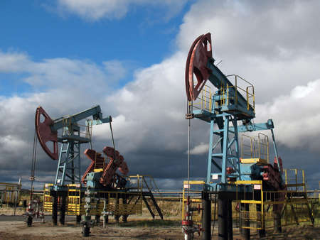 Clouds and pumps. West Siberia. Stock Photo - 7032619