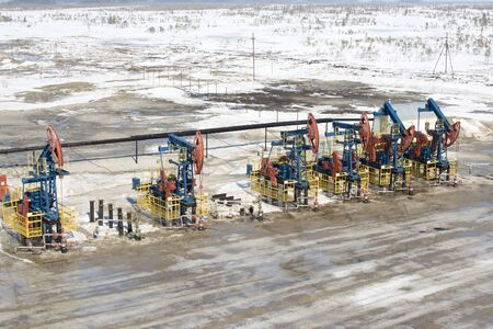 Oil pumps in West Siberia. Oil industry equipment photo