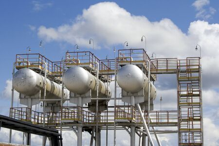 Oil refinery station. Steel reservoir  photo