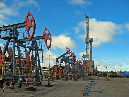 Work of oil industry. Construction and equipment of pump jack photo