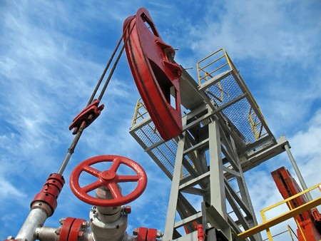 methane: Oil pump jack in work. Wide angle Stock Photo