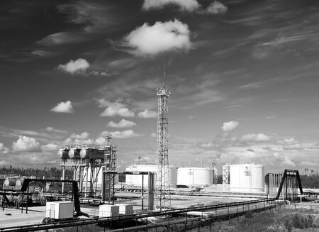Oil refinery plant. Petrochemical industry. Black and white photo