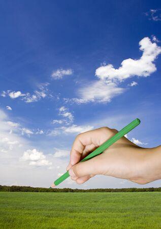 Kind tekenen een fantasie zomer landschap Stockfoto
