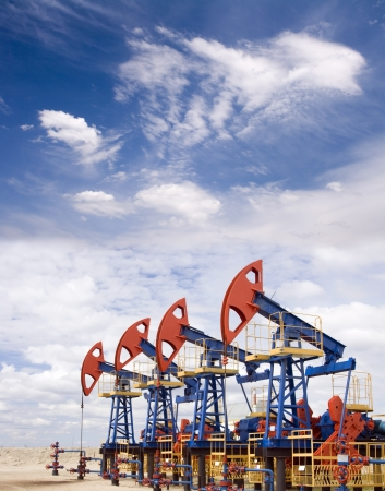 Pump jacks on a oil field Stock Photo