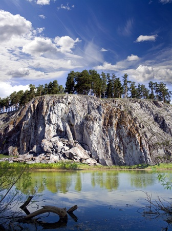 Beautiful lake and pines on a rock. Autumn landscape Stock Photo - 8871924