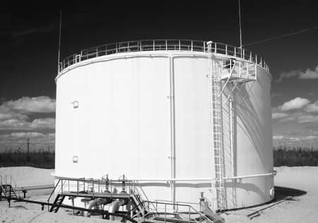 Oil reservoir on a petrochemical plant. Black and white photo photo