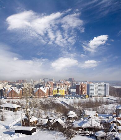 Cityscape of old and new district. Winter town photo