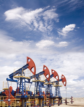 Oil and gas industry. Work of oil pump jack on a oil field. Stock Photo