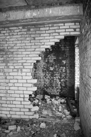 Ruins of a destroyed house. Abandoned building. War time. Black and white photo photo