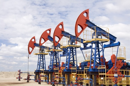 Oil and gas industry. Work of oil pump jack on a oil field. photo