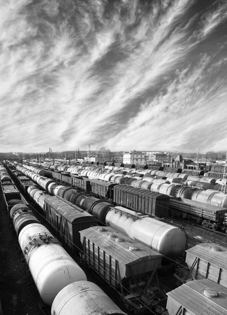 express lane: Railroad cars on a railway station. Cargo transportation. Work of industry. Urban scene. Black and white photo