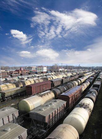 express lane: Railroad cars on a railway station. Cargo transportation. Work of industry. Urban scene