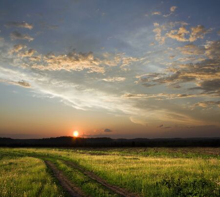 Beautiful sunset above rural lane. Square composition photo
