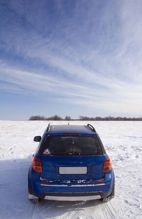 Winter off road travel. The machine is ready to storm winter impassability on a snow covered field. Start photo