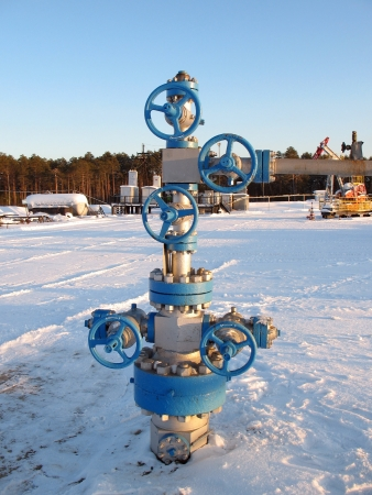 Oil and gas industry  Work of oil electric pump on a oil field  Extraction of oil  Oil industry of West Siberia photo