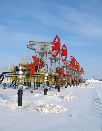 Oil and gas industry. Work of oil pump jack on a oil field. Extraction of oil. Oil industry of West Siberi photo
