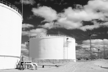 Oil industry and gas industry. Work of refinery petrochemical plant. Oil reservoir and storage tank of mineral oil photo