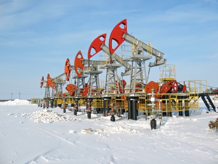 Oil and gas industry. Work of oil pump jack on a oil field. Winter extraction of oil. Oil industry of West Siberia  Stock Photo