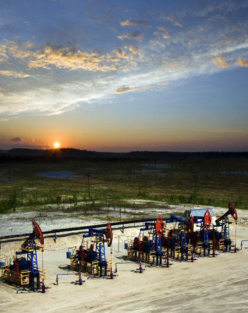 Beautiful sunset on oil extraction field in West Siberia. Russia oil and gas industry. Business and nature photo