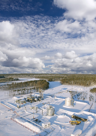 pipework: Industrial construction. Oil industry. Mounting of pipework in wild Siberian taiga. Gas transfer station.