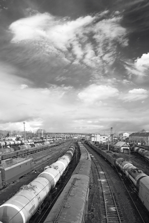goods train: Railway station. Cargo transportation of goods by rail. Train with storage tank. Black and white photo Stock Photo