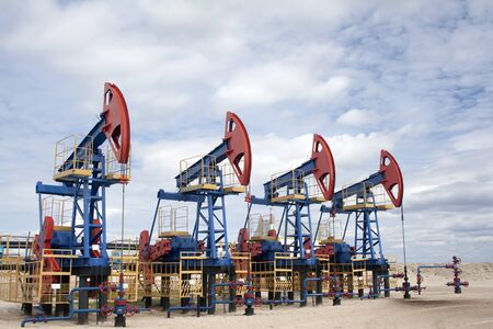 oil and gas industry: Oil industry and gas industry. Work of oil pump jack on a oil field. Oil equipment Stock Photo