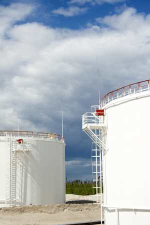 Oil and gas industry. Work of refinery petrochemical plant. Oil reservoir and storage tank. Gas station Stock Photo