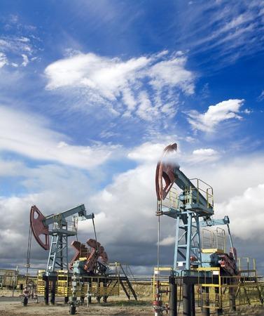 oil and gas industry: Oil industry. Gas industry.  White clouds above oil pumps