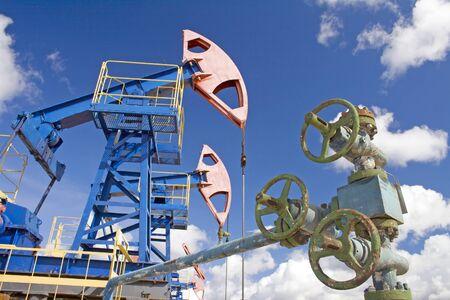 oil and gas industry: Oil industry and gas industry. Work of oil pump jack on a oil field. Oil latch