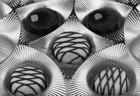 Open box of candies. Black and white photo