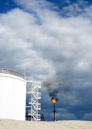 Oil reservoir and gas flame torch. Petrochemical plant. Gas factory Stock Photo